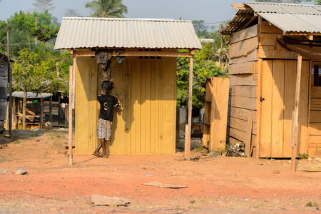 CENTRAL REGION, GHANA - Jan 17, 2017: Unidentified Ghanaian little boy from behind in local village. People of Ghana suffer of poverty due to the bad economy Editorial