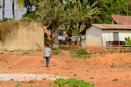 CENTRAL REGION, GHANA - Jan 17, 2017: Unidentified Ghanaian man walks from behind in local village. People of Ghana suffer of poverty due to the bad economy
