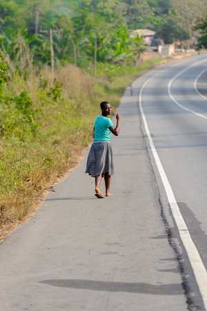 CENTRAL REGION, GHANA - Jan 17, 2017: Unidentified Ghanaian woman looks around in local village. People of Ghana suffer of poverty due to the bad economy