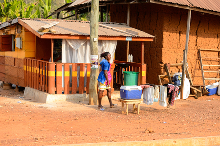 CENTRAL REGION, GHANA - Jan 17, 2017: Unidentified Ghanaian woma dries her clothes in local village. People of Ghana suffer of poverty due to the bad economy