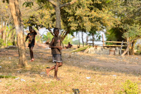 CENTRAL REGION, GHANA - Jan 17, 2017: Unidentified Ghanaian little boy walks in the garden in local village. Children of Ghana suffer of poverty due to the bad economy