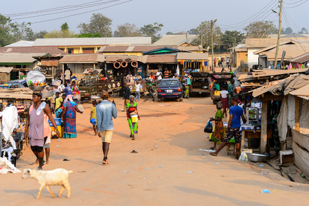 CENTRAL REGION, GHANA - Jan 17, 2017: Unidentified Ghanaian people walk  along the market in local village. People of Ghana suffer of poverty due to the bad economy