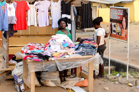 CENTRAL REGION, GHANA - Jan 17, 2017: Unidentified Ghanaian woman sells clothes in local village. People of Ghana suffer of poverty due to the bad economy