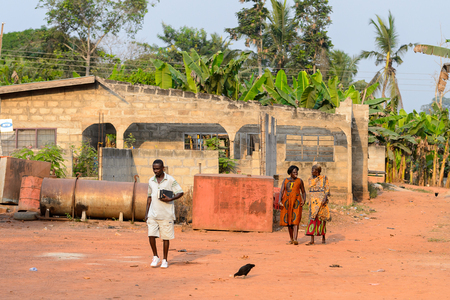CENTRAL REGION, GHANA - Jan 17, 2017: Unidentified Ghanaian people walk along the street in local village. People of Ghana suffer of poverty due to the bad economy