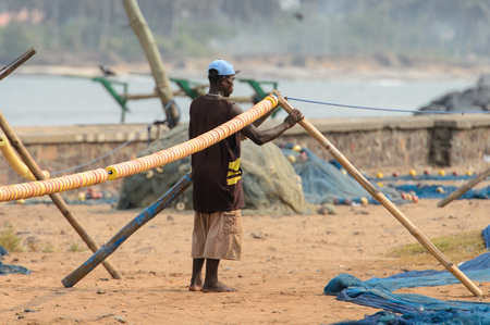 ELMINA, GHANA -JAN 18, 2017: Unidentified  Ghanaian man locates in Elmina port. People of Ghana suffer of poverty due to the bad economy Editorial