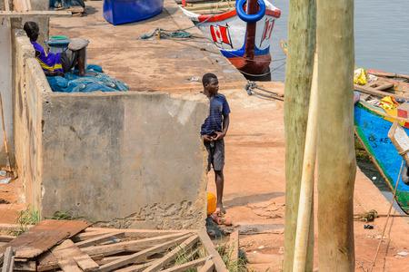 ELMINA, GHANA -JAN 18, 2017: Unidentified  Ghanaian man looks awayin Elmina port. People of Ghana suffer of poverty due to the bad economy