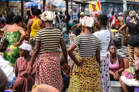 ELMINA, GHANA -JAN 18, 2017: Unidentified  Ghanaian people on the shore of Elmina port. People of Ghana suffer of poverty due to the bad economy