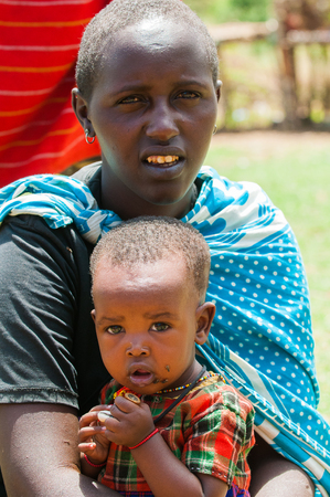 AMBOSELI, KENYA - OCTOBER 10, 2009: Portrait of an unidentified Massai woman with her little cute baby boy in Kenya, Oct 10, 2009. Massai people are a Nilotic ethnic group