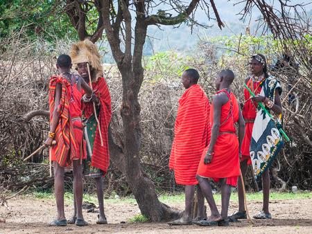 AMBOSELI, KENYA - OCTOBER 10, 2009: Unidentified Massai people with wooden sticks talking about something in Kenya, Oct 10, 2009. Massai people are a Nilotic ethnic group