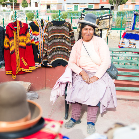 PERU - NOVEMBER 7, 2010: Unidentified Peruvian woman at the maket in Peru, Nov 7, 2010. Over 50 per cent of people in Peru live below the the poverty line.