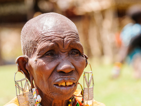 AMBOSELI, KENYA - OCTOBER 10, 2009: Portrait of an unidentified Massai extraordinary woman with heavy earings in Kenya, Oct 10, 2009. Massai people are a Nilotic ethnic group