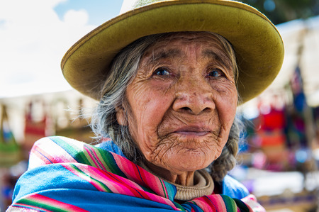 PERU - NOVEMBER 3, 2010: Unidentified Peruvian lady in the popular bowler hat in Peru, Nov 3, 2010. Over 50 per cent of people in Peru live below the the poverty line.