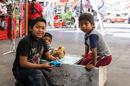 MEXICO CITY, MEXICO - DEC 29, 2011: Unidentified Mexican children play in the street. 60% of Mexican people belong to the Mestizo ethnic group Editorial