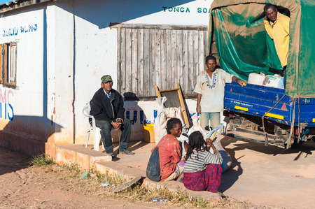 ANTANANARIVO, MADAGASCAR - JULY 3, 2011: Unidentified Madagascar people in the street with a truck. People in Madagascar suffer of poverty due to slow development of the country 報道画像