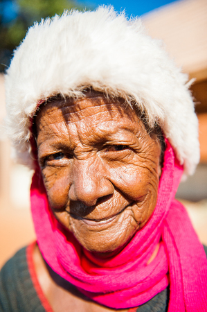 MADAGASCAR - JULY 1, 2011: Portrait of an unidentified woman in fluffy hat in Madagascar, July 1, 2011. Children of Madagascar suffer of poverty due to the unstable situation.