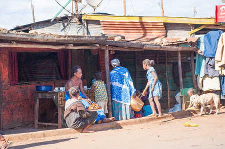 ANTANANARIVO, MADAGASCAR - JULY 3, 2011: Unidentified Madagascar people in the street. People in Madagascar suffer of poverty due to slow development of the country 報道画像