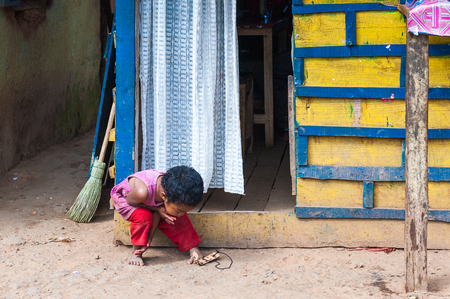 ANTANANARIVO, MADAGASCAR - JUNE 30, 2011: Unidentified Madagascar boy plays in the street. People in Madagascar suffer of poverty due to slow development of the country