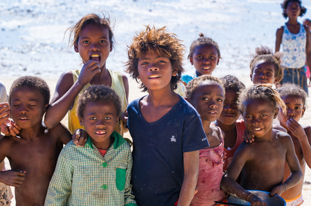 ANTANANARIVO, MADAGASCAR - JULY 3, 2011: Unidentified Madagascar smiling children pose for the camera. People in Madagascar suffer of poverty due to slow development of the country