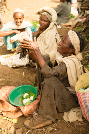 OMO, ETHIOPIA - SEPTEMBER 19, 2011: Unidentified Ethiopian woman works at the local market. People in Ethiopia suffer of poverty due to the unstable situation
