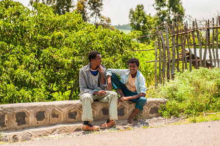 OMO, ETHIOPIA - SEPTEMBER 19, 2011: Unidentified Ethiopian men on the stones. People in Ethiopia suffer of poverty due to the unstable situation