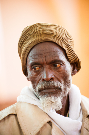 AKSUM, ETHIOPIA - SEP 24, 2011: Unidentified Ethiopian man ina yellow hat with white beard in Ethiopia, Sep.24, 2011. People in Ethiopia suffer of poverty due to the unstable situation