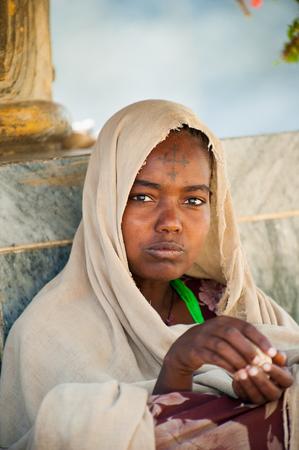 AKSUM, ETHIOPIA - SEP 24, 2011: Unidentified Ethiopian beautiful religious girl in Ethiopia, Sep.24, 2011. Children in Ethiopia suffer of poverty due to the unstable situation