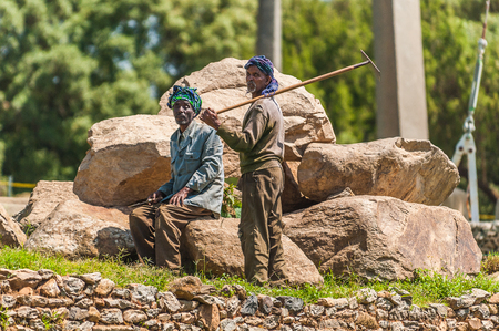 AKSUM, ETHIOPIA - SEPTEMBER 24, 2011: Unidentified Ethiopian men work. People in Ethiopia suffer of poverty due to the unstable situation