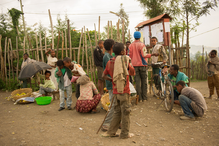 OMO, ETHIOPIA - SEPTEMBER 21, 2011: Unidentified Ethiopian people in the street. People in Ethiopia suffer of poverty due to the unstable situation Editorial
