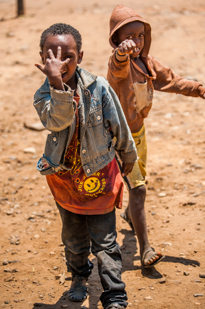 OMO, ETHIOPIA - SEPTEMBER 21, 2011: Unidentified Ethiopian boys in the street. People in Ethiopia suffer of poverty due to the unstable situation