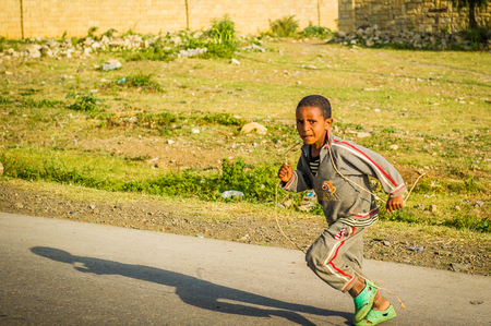 OMO, ETHIOPIA - SEPTEMBER 21, 2011: Unidentified Ethiopian boy runs in the street. People in Ethiopia suffer of poverty due to the unstable situation