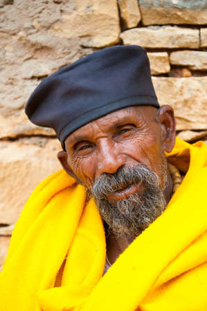 AKSUM, ETHIOPIA - SEP 24, 2011: Unidentified Ethiopian man in yellow tissue and black hat in Ethiopia, Sep.24, 2011. People in Ethiopia suffer of poverty due to the unstable situation