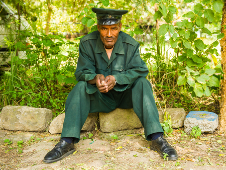 AKSUM, ETHIOPIA - SEPTEMBER 24, 2011: Unidentified Ethiopian man wearing military uniform. People in Ethiopia suffer of poverty due to the unstable situation