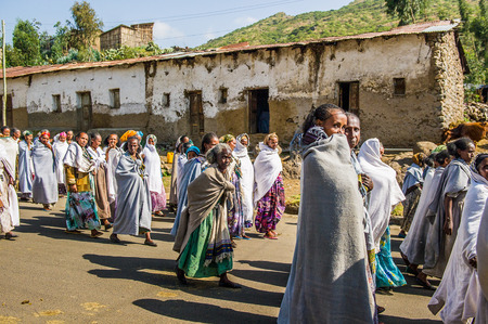 OMO, ETHIOPIA - SEPTEMBER 21, 2011: Unidentified Ethiopian women in white tissues in the street. People in Ethiopia suffer of poverty due to the unstable situation Editorial