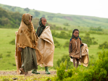 AKSUM, ETHIOPIA - SEPTEMBER 22, 2011: Unidentified Ethiopian children walk with the natural background. People in Ethiopia suffer of poverty due to the unstable situation