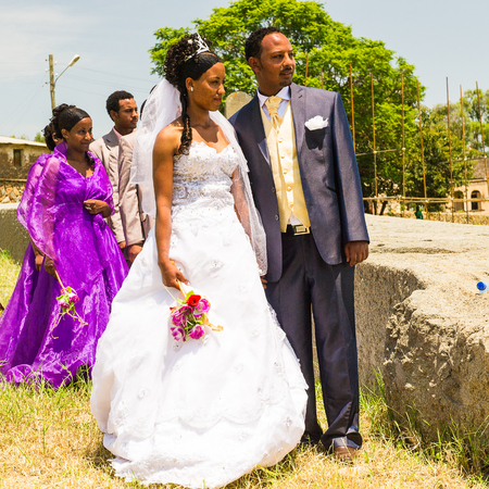 AKSUM, ETHIOPIA - SEPTEMBER 24, 2011: Unidentified Ethiopian bride and husband have a traditional Ethiopian wedding. People in Ethiopia suffer of poverty due to the unstable situation