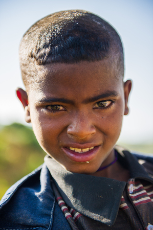 AKSUM, ETHIOPIA - SEP 24, 2011: Portrait of an unidentified Ethiopian boy in Ethiopia, Sep.24, 2011. People in Ethiopia suffer of poverty due to the unstable situation Editorial