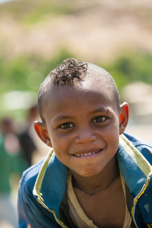 AKSUM, ETHIOPIA - SEP 24, 2011: Unidentified Ethiopian cute little boy with a funny haircut in Ethiopia, Sep.24, 2011. Children in Ethiopia suffer of poverty due to the unstable situation