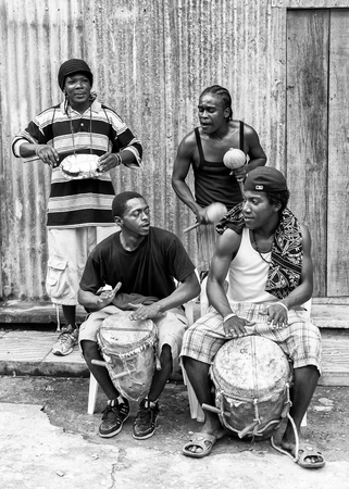 GUATEMALA - JANUARY 3, 2012: Portrait of unidentified musicians from Guatemala playing the drums, Jan 3, 2012. People of Guatemala suffer of poverty due to slow development of the country