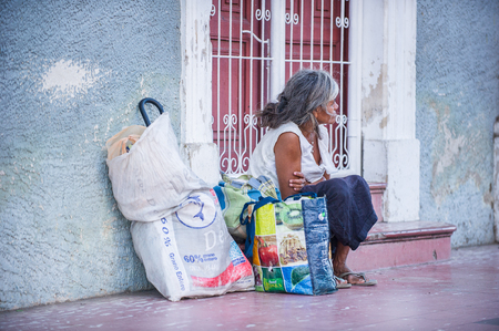 MANAGUA, NICARAGUA - JAN 6, 2012: Unidentified Nicaraguan woman with pockets. 69% of Nicaranguan people belong to the Mestizo ethnic group