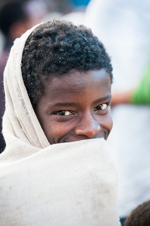 AKSUM, ETHIOPIA - SEP 27, 2011: Portrait of an unidentified Ethiopian woman in white tissue in Ethiopia, Sep.27, 2011. People in Ethiopia suffer of poverty due to the unstable situation 新闻类图片