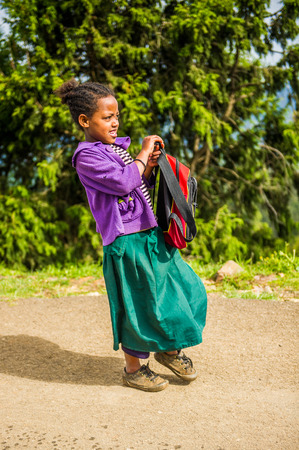 OMO, ETHIOPIA - SEPTEMBER 21, 2011: Unidentified Ethiopian girl goes to the school. People in Ethiopia suffer of poverty due to the unstable situation