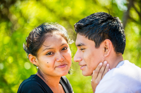 MANAGUA, NICARAGUA - JAN 6, 2012: Unidentified Nicaraguan girl and guy kiss each outher. 69% of Nicaranguan people belong to the Mestizo ethnic group