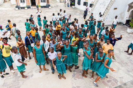 GHANA, ACCRA - MARCH 2, 2012: Students from different Ghanaian schools visiting the Elmina Castle in Accra, Ghana, on March 2nd, 2012. Elmina Castle is a UNESCO World Heritage site