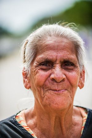 SAN JOSE, COSTA RICA - JAN 6, 2012: Unidentified Costa Rican smiling woman with white hair. 65.8% of Costa Rican people belong to the White (Castizo) ethnic group