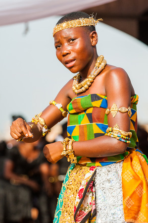 GHANA - MARCH 3, 2012: Ghanaian girl in national colors clothes  dances the traditional African dance in Ghana, on March 3rd, 2012. Music is the main kind of entertainment in Africa Editorial