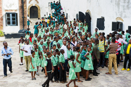 GHANA, ACCRA - MARCH 2, 2012: Group of students of the Saint Leo International School came to see the Elmina Castle in Accra, Ghana, on March 2nd, 2012. Children from all faiths may study in the St Leo School. Publikacyjne