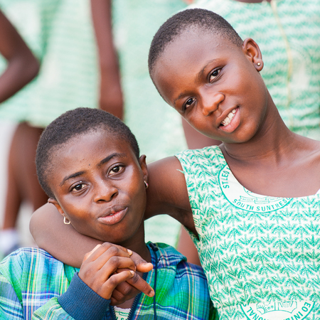GHANA, ACCRA - MARCH 2, 2012: Portrait of two friends from the Saint Leo International School who came to see the Elmina Castle in Accra, Ghana, on March 2nd, 2012. Children from all faiths may study in the St Leo School. Redakční