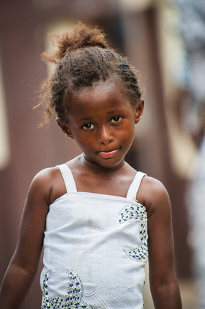 ACCRA, GHANA - MARCH 4, 2012: Unidentified Ghanaian beautiful girl in a dress portrait in Ghana. People of Ghana suffer of poverty due to the unstable economic situation Editorial