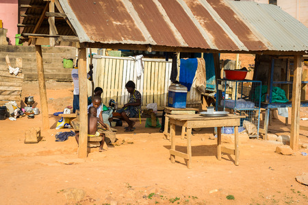 ACCRA, GHANA - MARCH 4, 2012: Unidentified Ghanaian people work at the market in the street in Ghana. People of Ghana suffer of poverty due to the unstable economic situation Editorial