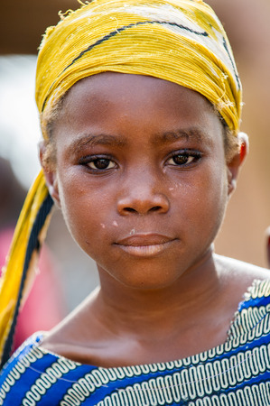 ACCRA, GHANA - MARCH 6, 2012: Unidentified Ghanaian beautiful sad girl in the street in Ghana. Children of Ghana suffer of poverty due to the unstable economic situation Editorial